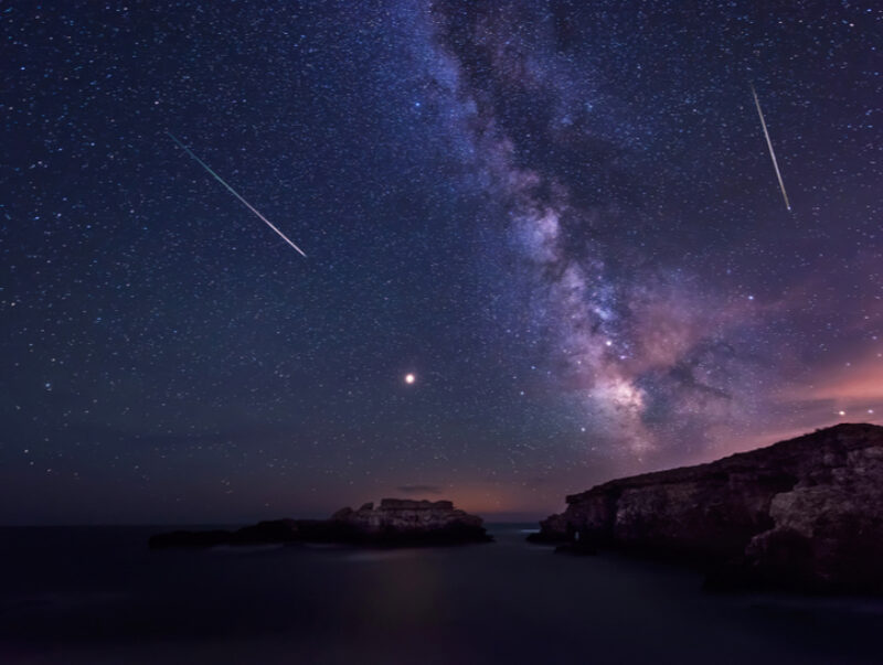 The Milky Way and two shooting stars in the night sky